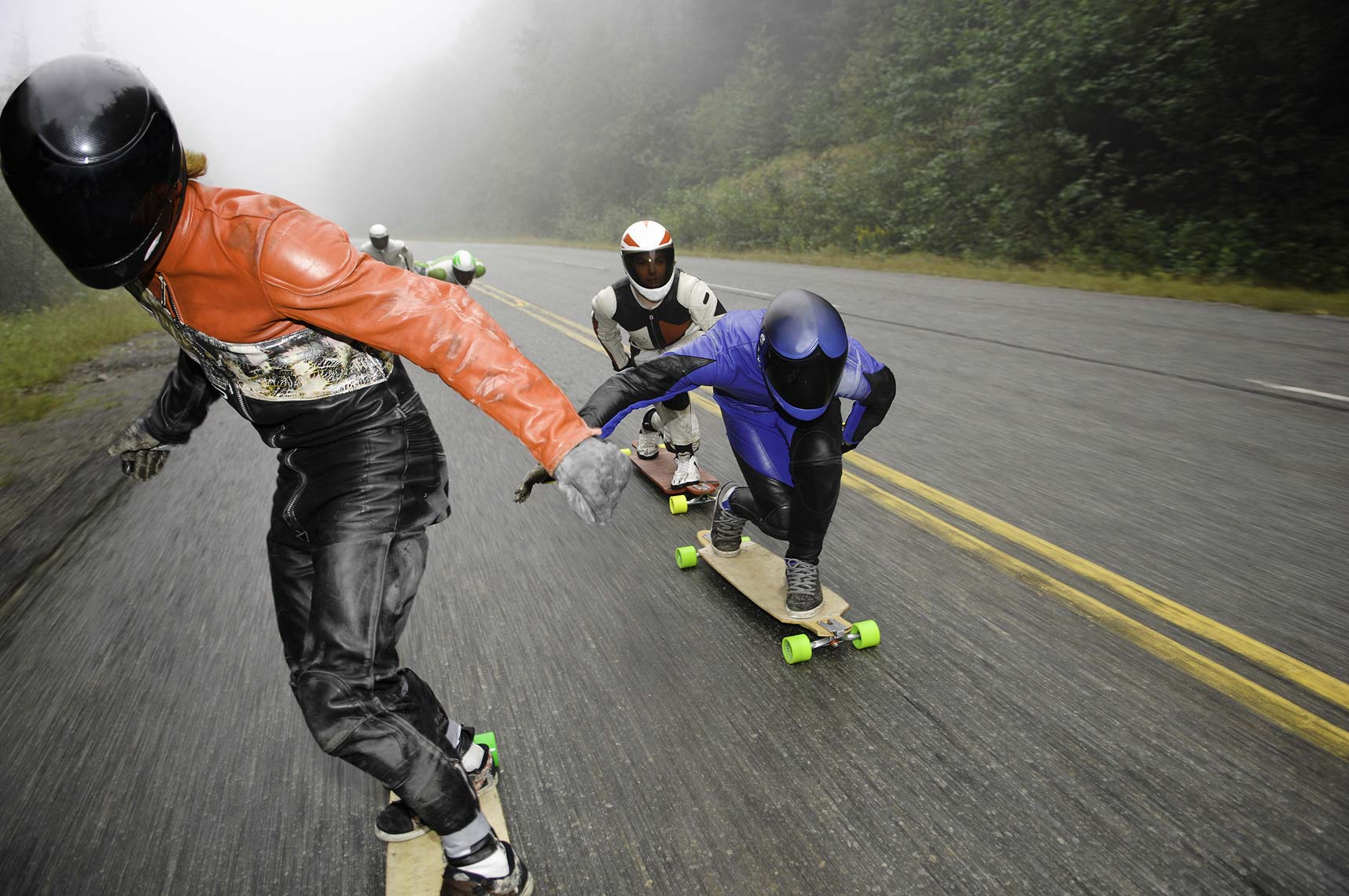 longboarders on road