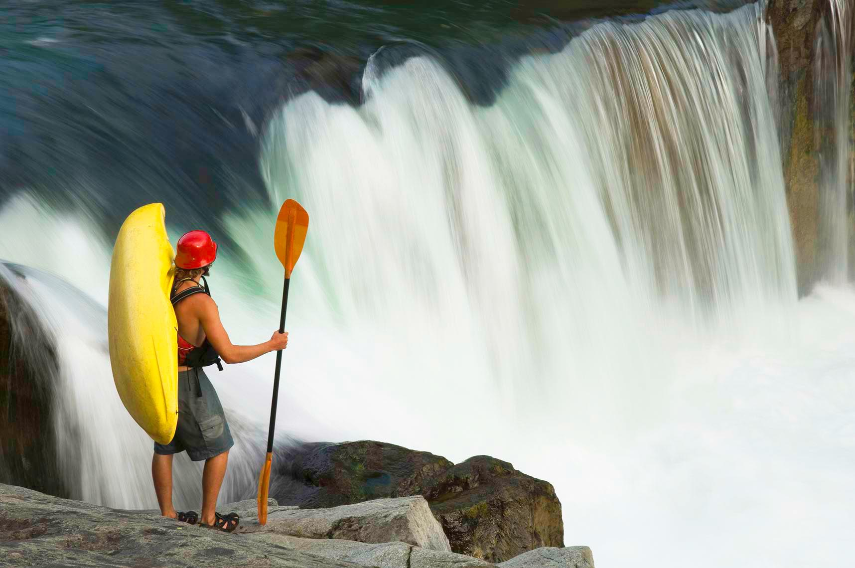 Whistler kayaker by waterfalls